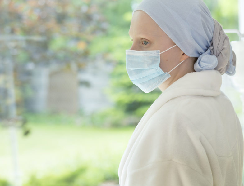 Sick woman with mask on face during treatment in the hospice